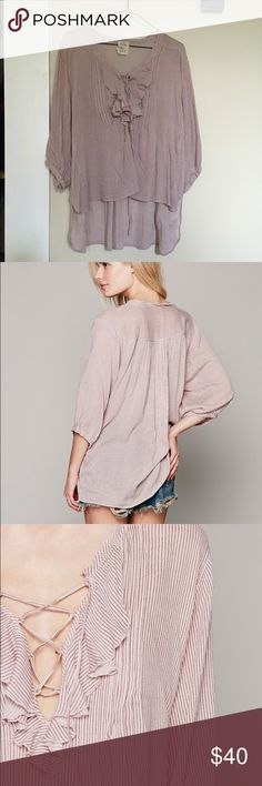Free People Ruffle Boho Blouse Free People Ruffle Blouse. Pin stripes, very like pink/purple color. Longer in the back. Lace up detail in front. Size xs/s, runs large. Free People Tops Blouses