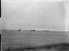 SEP 9 1943 The Italian front opens at Salerno In the distance landing ship tanks waiting to go inshore at Salerno while destroyers make smoke to cover them near the beaches. Photograph taken from the British minesweeper CIRCE.