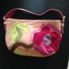 Authentic Coach Pink Flowered Suede Purse Authentic Coach purse. Limited edition pink flowered suede design. Only used once or twice, years ago... like new condition. One zippered pocket inside. Comes with dust bag. Coach Bags