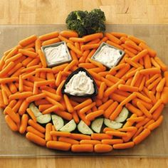 Jack o' Lantern Carrot Platter This pumpkin veggie tray has it all! The eyes and nose are used for the dip, and broccoli for the stem. Just arrange it on a large round platter for a Halloween party.