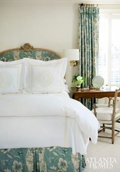Atlanta Homes & Lifestyles. Pure white, light weight bedding. Traditional print aqua and sage on linen headboard, bed skirt, and draperies. Custom work available DesignNashville