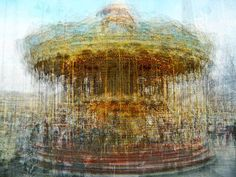 abstract composite images of carousels in various amusement parks around the world by photographing them from multiple angles and then blending the photographs together