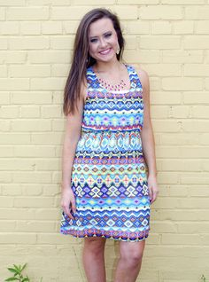 9ed6611794 This Color Me Happy aztec print dress is a must have for the season. Elastic
