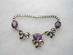 Deco Style Open Back Purple lucite  & Silver tone Bow Book Chain Choker Necklace by acrazeelady on Etsy https://www.etsy.com/listing/189565105/deco-style-open-back-purple-lucite
