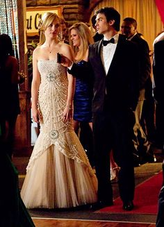 """The Prom Queen and Her Vampire King? Are Damon and Caroline bonding over their hatred of no-humanity Elena, drowning their sorrows, or getting ready to hit the dance floor? """" explains Leverett, who dressed both Salvatore boys in Armani tuxedos, but gave each of them their own signature cravat. """"Stefan's a four-in-hand kind of tie guy, Damon's more of a suave James Bond bow tie guy."""""""