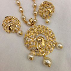 CZ pendant with pearl drops and earrings Code : PS 401 Price: Rps. 1295/- Whatsap to 09581193795 for order processing