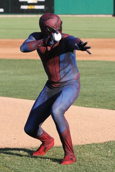 Spiderman throwing the first pitch.