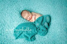 natural newborn girl photo on textured blanket