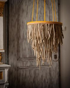 A chandelier crafted from driftwood makes a stunning focal point