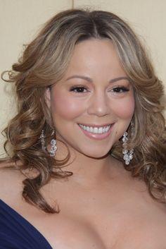 Mariah Carey wearing a long elegant curly hairstyle