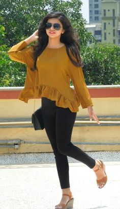 Mustard crop top with black high waist jeans and wedges for everyday formal look