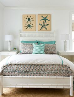 Turquoise Blue and White Bedroom with large Starfish Prints above headboard: http://beachblissliving.com/beach-home-wall-art-ideas/