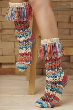 These socks are wild - in a good way! The vibrant colouring, the lace pattern and the tassels make these socks a fun project to knit and to wear. Knitted with Novita 7 Veljestä wool yarn Knitting ProjectsCrochet For BeginnersCrochet PatternsCrochet Bag Crochet Socks, Knitting Socks, Knit Crochet, Free Knitting, Lace Patterns, Knitting Patterns, Crochet Patterns, Easy Knitting Projects, Wool Socks