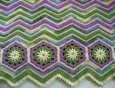 Daisy Border.....  Leisure Arts #3338, 40 Favorite Ripple Afghans - pattern available