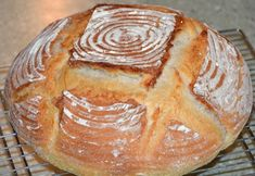 Plain white, simple sourdough bread. A great starter recipe to use if you are new to sourdough baking. The dough cycle of the bread machine can be used to prepare the dough, if you like. Prep time does not include proofing time for starter.