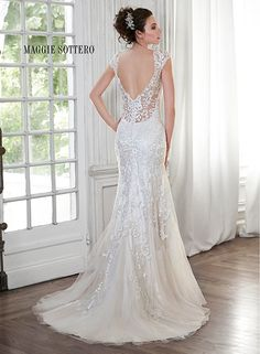 Slim A-line lace wedding dress with illusion sweetheart neckline and elegant lace cap-sleeves, Petunia by Maggie Sottero.