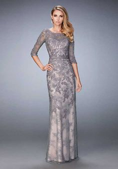 Beautiful evening gown with a lace overlay and fitted belt. Embellished with jewels along the bodice, and 3/4 length sheer sleeves. Back zipper closure. Evening Size Chart B.