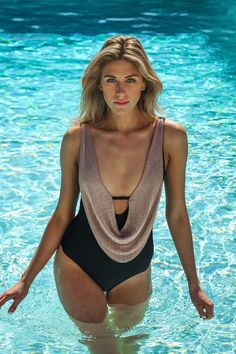 df41e62900 Live in luxury in this slimming one piece bathing suit. The Luxe By Lisa  Vogel