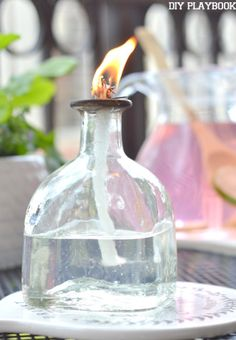 http://thediyplaybook.com/2015/05/patron-bottle-citronella-candle.html