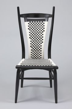 Modern & graceful take on a classic woven back chair. You can pick whatever colors of shaker tape you'd like for the weaving, but this black and white is so graphic and timeless!