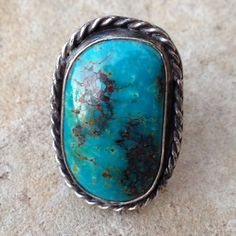 """Vintage Gorgeous Sterling Turquoise Ring Large Oval/Round stone, Bezel Set with Rope Design around 10x25mm Natural Turquoise Stone with lots of Brown Matrix, Sterling Ring, Double Shank, Head Measures 1 3/16"""" X 13/16"""", double shank/ Band is 7mm wide in back, Lots of Patina, will clean upon request. Jewelry Rings"""