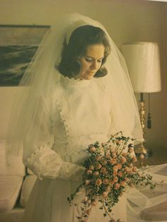 Vintage 1960s Romantic Bride. The dress looks dated, but I love the veil and would wear it today.