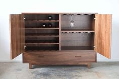 LOVE these handmade furniture pieces! Clean lines and quality work. Made in the USA in Indiana!  Solid Walnut Wine Cabinet with Drawer by hedgehouse on Etsy, $1835.00