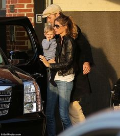 Time with the family: Gisele Bundchen looked dressed down as she arrived in Boston with her family on Sunday afternoon