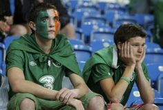 Ireland fans sit dejected in the stands after their teams defeat to Croatia in the Group C Euro 2012 soccer match at the city stadium in Poznan, June 10, 2012. REUTERS/Kacper Pempel (POLAND - Tags: SPORT SOCCER)
