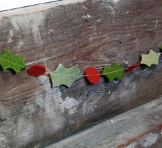 Christmas Holly Garland - this looks like it is felt - maybe great for the kids but maybe I can find another way to make something like this with something a little heavier.