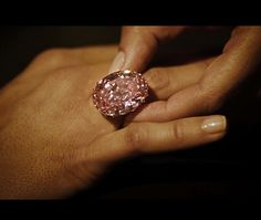 The 59.6-carat Pink Star diamond sold today, 11/13/13, for a record 83.4 million dollars.  Its auction estimate was 60 million.  It was bought by a New York diamond cutter who has renamed it 'Pink Dream'.