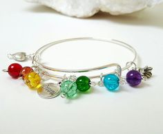 Items similar to Healing Chakra Energy Bangle Heart flower dream charm gift mother daughter sister friend teacher Irish glass beads Made in Ireland on Etsy Heart Flower, Chakra Jewelry, Bangles, Bracelets, Healing, Trending Outfits, Unique Jewelry, Makeup, Handmade Gifts