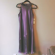 BUY ME!!! Make an offer! NWT Lilac Satin Dress SO BEAUTIFUL!MAKE AN OFFER!  Absolutely gorgeous lilac satin dress from Jones New York.  Metal embellishments at both shoulders are hematite plated with clear crystals.  So beautiful- the way it hangs and fits is kinda 1920's Gatsby-esque in my opinion.   Never worn, tags still attached.  Feel free to make a reasonable offer!   I LOVE this color!  The color is so great it would be worth having it tailored to the perfect fit.   Take advantage of…