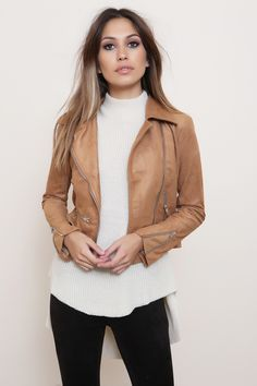 Vegan suede moto jacket. Zipper embellishments. Style #: 55-130LJ Material: Polyester/Spandex Color: Tan Model is wearing a small