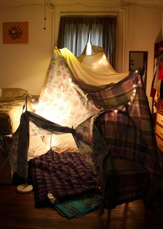 Tents made from blankets and couch cushions.