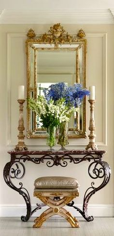 A Formal Look for the entry way. I love that wrought iron table!!!