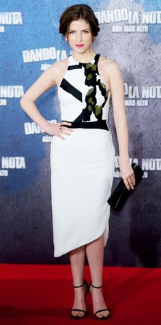 Anna Kendrick struck a pose at the Pitch Perfect 2 photocall in Madrid in a black-and-white crepe Narciso Rodriguez dress with olive embroidery at the bodice. Diamond studs, a black clutch, and black sandals completed her look.
