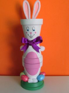 Hand-Painted Clay Pot Easter Bunny Shelf-sitter - Stands Approximately 11 tall, paint protected with a coat of Clear, Matte Varnish - Great Easter décor! Can just sit on a shelf or desk for Easter time, or can put candy in the top clay pot Clay Pot Projects, Clay Pot Crafts, Easter Projects, Easter Crafts, Craft Projects, Craft Ideas, Flower Pot Art, Clay Flower Pots, Flower Pot Crafts