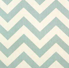 Blue, teal chevron fabric. To use as backing on a new bookcase I got.