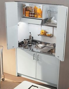 The Italian Hideaway range are exclusively produced by Euromobil for John Strand. This small kitchen offers real style and elegance. Micro Kitchen, Compact Kitchen, Kitchen Small, Tiny Spaces, Small Apartments, Micro House, Compact Living, Tiny House Movement, Tiny House Living