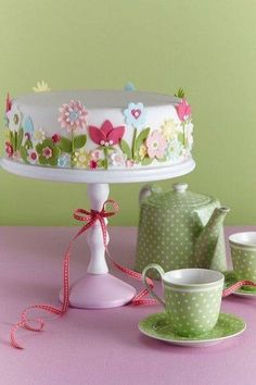 Green and white polka dotted tea set