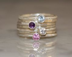 4 Gemstones, Birthstone stacking rings, Mothers and Family rings, 7 skinny rings, Argentium sterling silver, Custom made de sherisdesigns en Etsy https://www.etsy.com/es/listing/99413126/4-gemstones-birthstone-stacking-rings