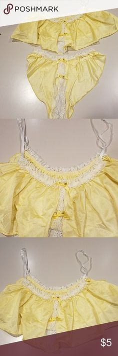 Sexy 2 pc yellow & white Adjustable straps on the top,  yellow ribbon bows an lace. Bottoms are crotchless with yellow bows an lace.  Last pick shows small hole. One size Intimates & Sleepwear