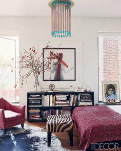 A Bert Stern photograph of Marilyn Monroe  is displayed in the bedroom; the vintage ceiling fixture is by  Ettore Sottsass, the vintage bench is from Brenda Antin, and the cowhide rug is from ABC Carpet & Home.
