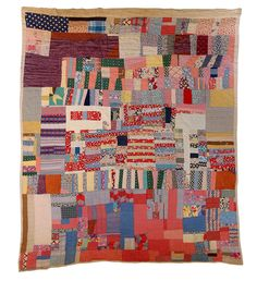 Strip quilt made of housetop strips and triangles Louisiana, c. 1940s, mixed fabrics