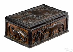 Folk art carved and painted pine dresser box, 19th c., deeply carved with relief animals - Price Estimate: $800 - $1200