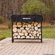 wood rack with cover that lowers with shrinking wood stack.  free shipping