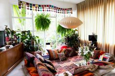 Create a lounge pit of kilims for the garden party feel inside