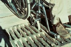 Article By Universal Design Style: big openings in grates can be a hazard for wheels, high heels, walkers, and crutches. This one is at a crosswalk.
