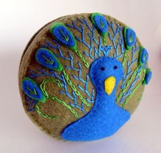 Peacock pincushions. Almost too cute to use.